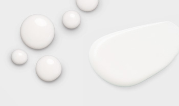 A picture of small and medium sized dots of skin care products on a white background